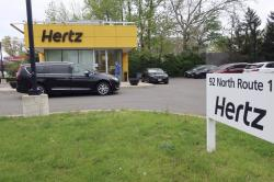 In this May 6, 2020, file photo, a Hertz car rental is closed during the coronavirus pandemic in Paramus, N.J.