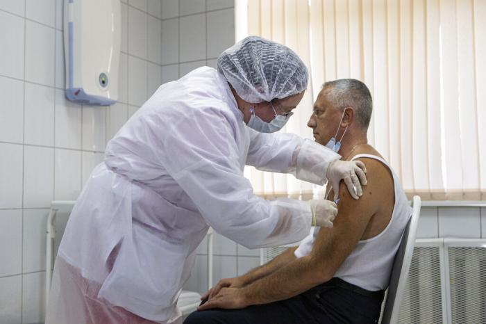 A Russian medical worker administers a shot of Russia's experimental Sputnik V coronavirus vaccine in Moscow, Russia.