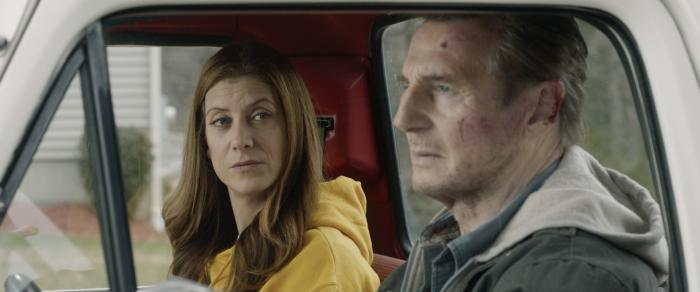 """Kate Walsh, left, and Liam Neeson in a scene from """"Honest Thief."""""""