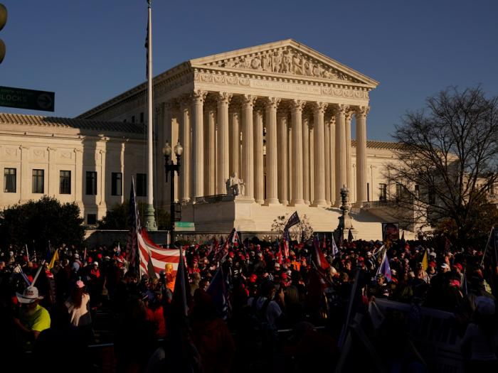 In this Nov. 14., 2020, file photo supporters of President Donald Trump attend pro-Trump marches outside the Supreme Court Building in Washington