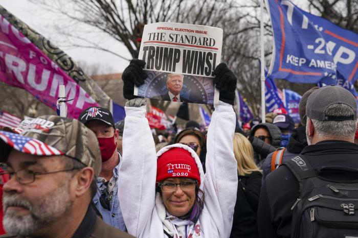 Trump supporters participate in a rally Wednesday, Jan. 6, 2021 in Washington. (AP Photo/John Minchillo)