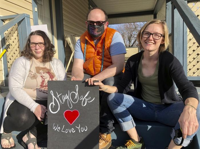 Solutions Oriented Addiction Response co-founder Sarah Stone, left, co-founder Joe Solomon, center, and group organizer Brooke Parker pose for a portrait in Charleston, W.Va.