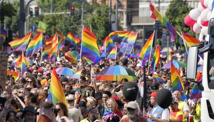 People take part in the Equality Parade, the largest gay pride parade in central and eastern Europe, in Warsaw, Poland, Saturday June 19, 2021